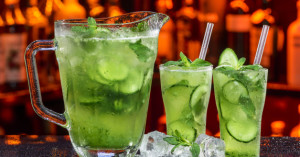 fresh summer coctail in ice by cucumber
